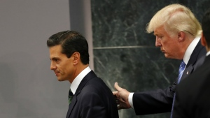 Republican presidential nominee Donald Trump walks with Mexico President Enrique Pena Nieto at the end of their joint statement at Los Pinos, the presidential official residence, in Mexico City on Wednesday, Aug. 31, 2016. (AP / Dario Lopez-Mills)