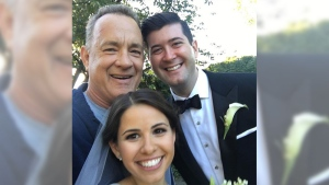 Jogging Tom Hanks crashes couple's wedding photos