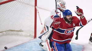 Montreal Canadiens' Alexander Radulov, from Russia, celebrates after scoring the first goal against Washington Capitals goaltender Vitek Vanecek, from the Czech Republic, during first period NHL pre-season hockey action Tuesday, September 27, 2016 in Montreal. THE CANADIAN PRESS/Ryan Remiorz