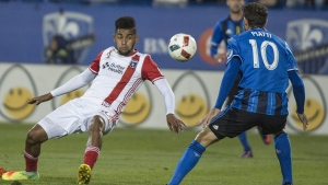 San Jose Earthquakes forward Henok Goitom slips after kicking the ball in front of Montreal Impact midfielder Ignacio Piatti during first half MLS action Wednesday, September 28, 2016 in Montreal. THE CANADIAN PRESS/Paul Chiasson