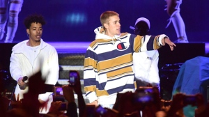 Justin Bieber, centre, performs on the Virgin Media Stage during the V Festival at Hylands Park in Chelmsford, Britain, Saturday, Aug. 20, 2016. (Ian West/PA via AP)