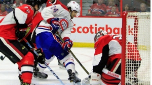 Montreal Canadiens' Phillip Danault (24) attempts to get the puck past Ottawa Senators goalie Andrew Hammond (30) as his teammate Thomas Chabot (72) looks on during first period pre-season NHL hockey action, in Ottawa on Saturday, October 1, 2016. THE CANADIAN PRESS/Fred Chartrand