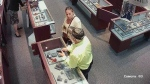 Police are trying to identify this man and woman in connection with a robbery at a Saint John jewelry store. (Saint John Regional Police)