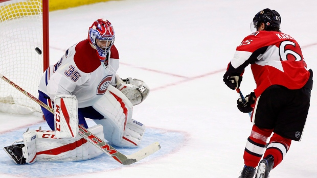 Ottawa Senators' Erik Karlsson (65) shoots the puck past Montreal Canadiens goalie Al Montoya (35) to beat the Canadiens 4-3 in shootout NHL action, in Ottawa on Saturday, October 15, 2016. (THE CANADIAN PRESS / Fred Chartrand)