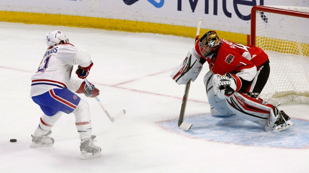 Montreal Canadiens' David Desharnais (51) fans on a shot against Ottawa Senators goalie Craig Anderson (41) during shootout NHL action, in Ottawa on Saturday, October 15, 2016. THE CANADIAN PRESS/Fred Chartrand