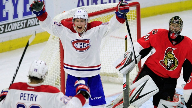 Montreal Canadiens' Artturi Lehkonen (62) celebrates his teammate Jeff Petry's (26) goal during second period NHL hockey action against the Ottawa Senators, in Ottawa on Saturday, October 15, 2016. THE CANADIAN PRESS/Fred Chartrand