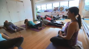 Happy Tree owner and instructor Melanie Richards is fighting to save the free yoga class.