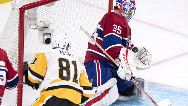 Montreal Canadiens goalie Al Montoya makes a save off Pittsburgh Penguins' Phil Kessel during second period NHL hockey action Tuesday, October 18, 2016 in Montreal. THE CANADIAN PRESS/Paul Chiasson