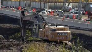 A construction crane at work near the Champlain bridge on Oct. 19, 2016