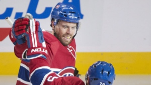 Montreal Canadiens' Shea Weber (6) celebrates with teammate Andrei Markov (79) after scoring against the Arizona Coyotes during second period NHL hockey action in Montreal, Thursday, October 20, 2016. THE CANADIAN PRESS/Graham Hughes