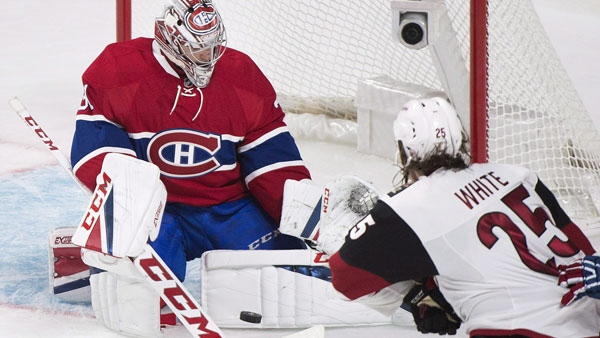 Montreal Canadiens goaltender Carey Price makes a save against Arizona Coyotes' Ryan White THE CANADIAN PRESS/Graham Hughes