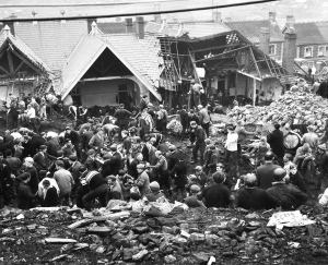 In this Oct. 22, 1966 file photo, rescue workers shovel the wet coal waste 28 hours after it slipped down the man-made mountain of coal waste and engulfed the Pantglas Junior School, and some houses, in Aberfan, Wales. (AP Photo/File)