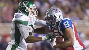 Saskatchewan Roughriders' Shane Herbert, left, tackles Montreal Alouettes' Nik Lewis during second half CFL football action in Montreal on July 29, 2016. The Saskatchewan Roughriders and the Montreal Alouettes have similar records, but their recent play shows two teams going in different directions heading into Saturday's match at Mosaic Stadium. THE CANADIAN PRESS/Graham Hughes