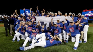 Chicago Cubs players celebrate after Game 6 of the National League baseball championship series against the Los Angeles Dodgers, Saturday, Oct. 22, 2016, in Chicago. (David J. Phillip/AP Photo)