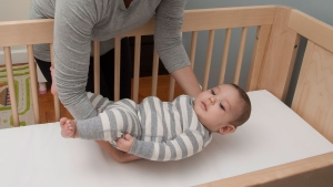 To reduce the risk of sudden death, babies should sleep in the same room as their parents but in their own crib or bassinet for the first year of life, U.S. doctors said. (NICHD / Flickr)
