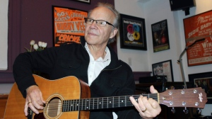 In this Dec. 18, 2013 file photo, Bobby Vee plays the guitar at his family's Rockhouse Productions in St. Joseph, Minn. Vee, whose rise toward stardom began as a 15-year-old fill-in for Buddy Holly after Holly was killed in a plane crash, died Monday Oct. 24, 2016 of complications from Alzheimer's disease. He was 73. (AP Photo/Jeff Baenen, File)