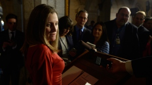 International Trade Minister Chrystia Freeland talks to reporters about the Canada-European Union trade deal in the foyer outside the House of Commons on Parliament Hill in Ottawa on Monday, October 24, 2016. THE CANADIAN PRESS/Adrian Wyld