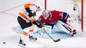 Philadelphia Flyers' Nick Cousins, left, loses the puck as he goes up to Montreal Canadiens goalie Carey Price during first period NHL hockey action, in Montreal on Monday, October 24, 2016. THE CANADIAN PRESS/Paul Chiasson