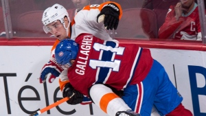Philadelphia Flyers' Ivan Provorov (9) is taken out by Montreal Canadiens' Brendan Gallagher (11) during second period NHL hockey action, in Montreal on Monday, October 24, 2016. THE CANADIAN PRESS/Paul Chiasson