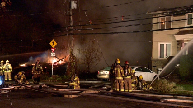 Two homes are a total loss and a third was damaged by water after a fire in Laval. (CTV Montreal / Cosmo Santamaria)
