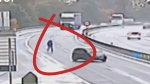Man chases his car down a highway