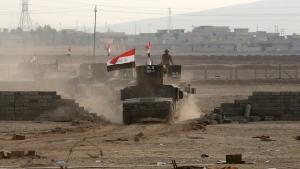 Iraq's elite counterterrorism forces advance toward Islamic State positions in the village of Tob Zawa near Mosul, Iraq, on Oct. 25, 2016. (Khalid Mohammed / AP)