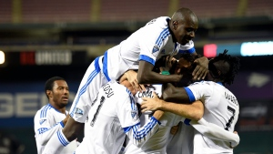 Montreal Impact defender Hassoun Camara, top, and Dominic Oduro (7) and others celebrate a goal by Laurent Ciman, second from right, during the first half of an MLS playoff soccer match against D.C. United, Thursday, Oct. 27, 2016, in Washington. (AP Photo/Nick Wass)