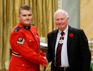 RCMP Constable Curtis Barrett, of Chelsea, Que., receives the Star of Courage from Governor General David Johnston during the Bravery Awards at Rideau Hall, in Ottawa on Friday, October 28 2016. (Fred Chartrand / THE CANADIAN PRESS)