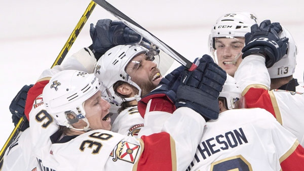 Florida Panthers defenceman Aaron Ekblad, centre, celebrates with teammates after scoring the winning goal during overtime against the Montreal Canadiens. THE CANADIAN PRESS/Ryan Remiorz