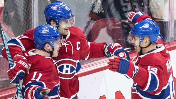 Montreal Canadiens' Max Pacioretty (67) celebrates with teammates Tomas Plekanec (14) and Brendan Gallagher (11). THE CANADIAN PRESS/Graham Hughes