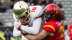 Laval Rouge et Or Marc-Antoine Pivin (10) scores a touch down despite pressure from Calgary Dinos' Hunter Turnbull (28) during first half U Sports Vanier Cup championship football action, in Hamilton, Ont., on Saturday, November 26, 2016. THE CANADIAN PRESS/Nathan Denette