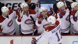 Montreal Canadiens right wing Brendan Gallagher (11) is congratulated by the bench after scoring during the third period of an NHL hockey game against the Detroit Red Wings, Saturday, Nov. 26, 2016, in Detroit. (AP Photo/Carlos Osorio)