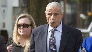 """In this Nov. 2, 2015, file photo, former professional wrestler Jimmy """"Superfly"""" Snuka, right, arrives for his formal arraignment at the Lehigh County Courthouse in Allentown, Pa. Snuka is set to again appear in court on August 2, 2016. (Michael Kubel/The Morning Call via AP, File)"""