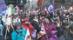 Hundreds of demonstrators marched to Premier Couillard's office to call for a reinvestment into the daycare system.