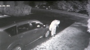 The security video footage shows a man approaching a vehicle, bending down and slicing the tires. (Provided)
