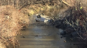 A woman is dead after a car flipped into a ravine near the St-Eustache Quarry on Sunday morning.