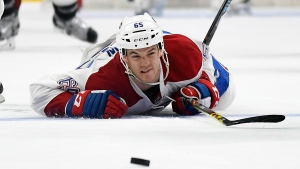 Montreal Canadiens center Andrew Shaw dives for the puck during the second period of an NHL hockey game against the Los Angeles Kings, Sunday, Dec. 4, 2016, in Los Angeles. (AP Photo/Mark J. Terrill)