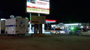 Montreal police set up a command post at the Esso station on St. Jean Baptiste Blvd. and Sherbroooke St., where one woman was shot and killed on Dec. 4, 2016 (CTV Montreal/Cosmo Santamaria)