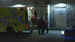 A woman was placed in an ambulance at the Esso station where a 49-year-old woman was murdered on Dec. 4, 2016