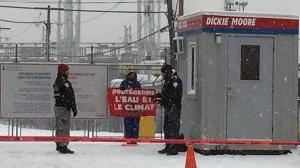Police talk to a Greenpeace protester at the Port of Montreal on Dec. 5, 2016 (CTV Montreal/Caroline Van Vlaardingen)