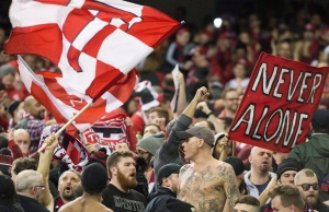 Toronto FC fans cheer on their team at the MLS Eastern Conference final against the Montreal Impact in Montreal, Tuesday, November 22, 2016. (Graham Hughes / THE CANADIAN PRESS)