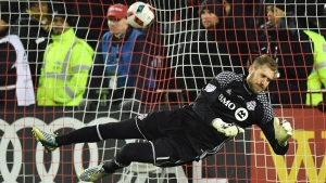 Toronto FC goalkeeper Clint Irwin (1) dives to make a save as the game-winning goal goes in the net from Seattle Sounders defender Roman Torres (not shown) during penalty kicks in the MLS Cup final action in Toronto on Saturday, Dec. 10, 2016. (THE CANADIAN PRESS / Frank Gunn)