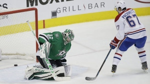 Montreal Canadiens left wing Max Pacioretty (67) scores the game winning goal against Dallas Stars goalie Kari Lehtonen (32). (AP Photo/LM Otero)