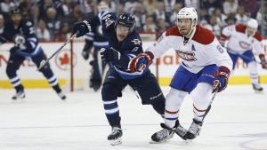Winnipeg Jets' Andrew Copp (9) and Montreal Canadiens' Shea Weber (6) scramble for the puck during second period NHL action in Winnipeg on Wednesday, January 11, 2017. THE CANADIAN PRESS/John Woods
