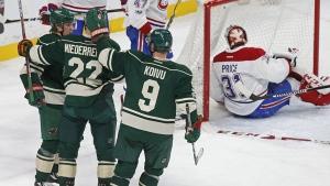 Montreal Canadiens goalie Carey Price winds up sitting in goal after Minnesota Wild's Nino Niederreiter scored. (AP Photo/Jim Mone)