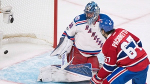 Montreal Canadiens captain Max Pacioretty scores against New York Rangers goaltender Henrik Lundqvist during third period NHL hockey action in Montreal, Saturday, January 14, 2017. THE CANADIAN PRESS/Graham Hughes