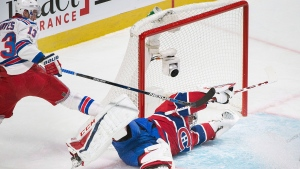 Montreal Canadiens goaltender Carey Price makes a save against New York Rangers' Kevin Hayes during second period NHL hockey action in Montreal, Saturday, January 14, 2017. THE CANADIAN PRESS/Graham Hughes