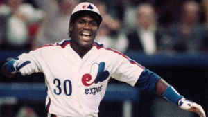 Montreal Expos' Tim Raines heads for first after earning a bases-loaded ninth-inning walk to give the Expos the lead in Montreal, on April 4, 1989. (THE CANADIAN PRESS/Bill Grimshaw)