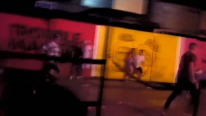 In this image taken from video, people are seen running after a gunman opened fire outside a club in Playa Del Carmen, Mexico.