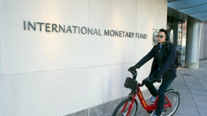 The International Monetary Fund (IMF) headquarters is seen Monday, Dec. 19, 2016, in Washington. (AP Photo/Cliff Owen)